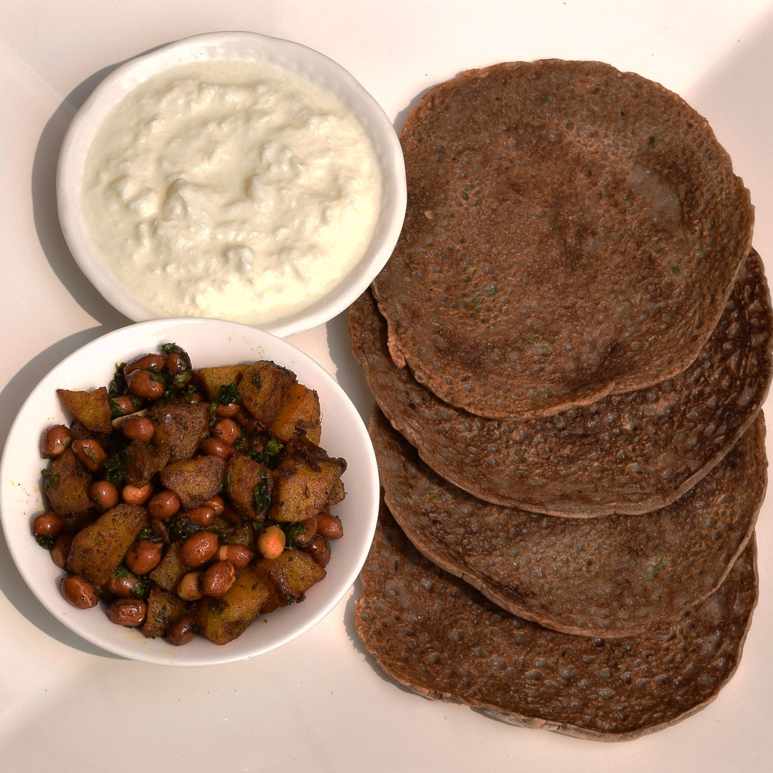 Singhare ka atta chilla with potatoes and peanuts